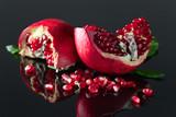 ripe pomegranate on a black table