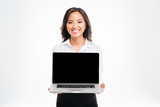 Beautiful smiling asian businesswoman showing laptop with blank screen