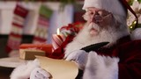 Portrait of Santa Claus writing on list