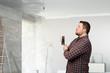 Handyman with tool in interior . Mixed media