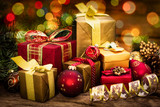 Fototapety Christmas gifts on the wooden background