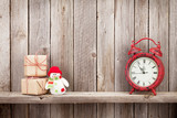 Christmas gift boxes, alarm clock and snowman