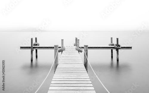 Wooden pier on the lake. Fog. Long exposure. Black and White. - 120623013