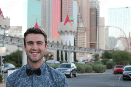 Portrait of attractive man in the city with copy space