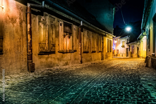 Dark deserted alley by night, in Sibiu, Romania (hollywood effect processing)
