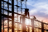 Silhouette of worker. Construction Building casting concrete work on scaffolding. - 120678253