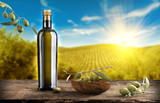 Bottle of oil with olive branch - 120678434