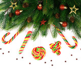 Christmas tree branches with decoration and candy