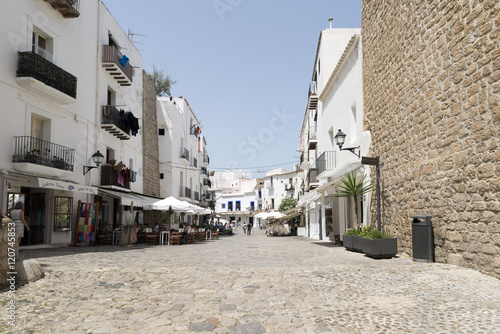 IBIZA, SPAIN - MAY 13, 2015: Pedestrian street in Ibiza Town, Balearic Islands, Spain. With a population of 48,484, the city is the capital of this tourist island