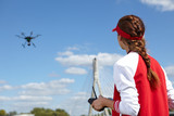 woman holding  drone uav over a field. Aerial video and photo