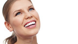Fototapety Close-up portrait of pretty woman with white toothy smile isolated over white background. Concept of dental care and fresh breath.