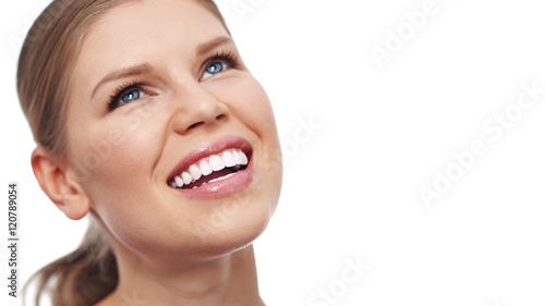 Close-up portrait of pretty woman with white toothy smile isolated over white background. Concept of dental care and fresh breath.
