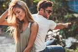 Beautiful young couple on a motorcycle