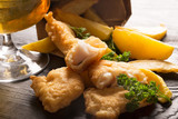 Traditional British fish and chips with parsley
