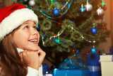 Cute teenage girl under the Christmas tree