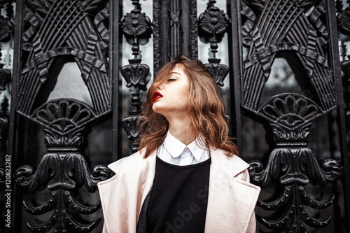 Vintage Street fashion photo. Beautiful young woman in oversize
