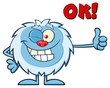 Cute Little Yeti Cartoon Mascot Character Winking And Holding A Thumb Up. Illustration Isolated On White Background With Text OK!