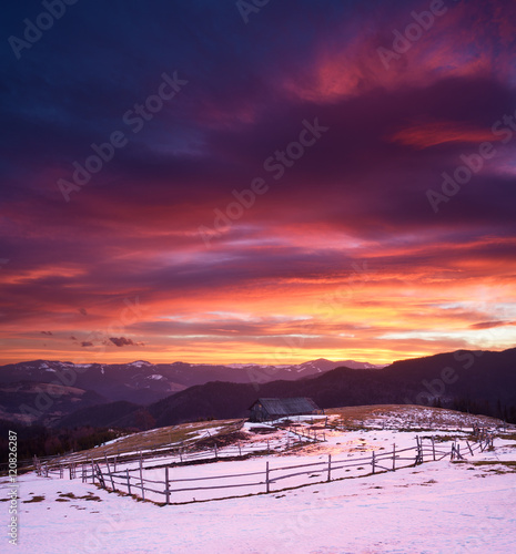 Keuken foto achterwand Crimson Beautiful sunrise in mountain village