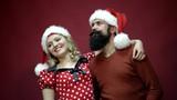 young bearded Santa kisses a girl
