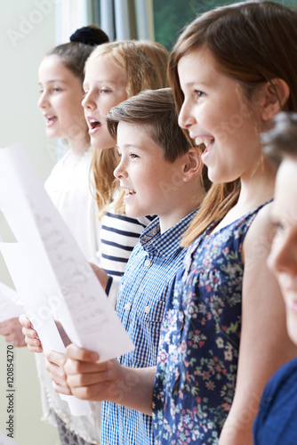 Group Of Children Enjoying Singing Group