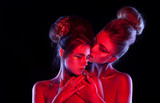 Hot lesbian couple in conceptual beauty portrait