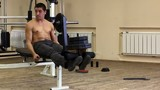 Attractive Young Man Doing Leg Press On Machine In Gym