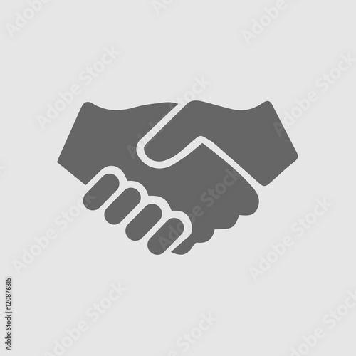 Partnership vector. Handshake icon. Hand shaking vector icon. Black illustration isolated on grey background.