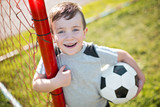 Young caucassian soccer player football