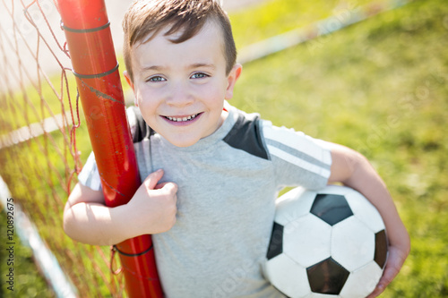 Fotobehang Voetbal Young caucassian soccer player football