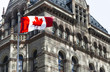 Beautiful Canada flag is waving front of a historical building