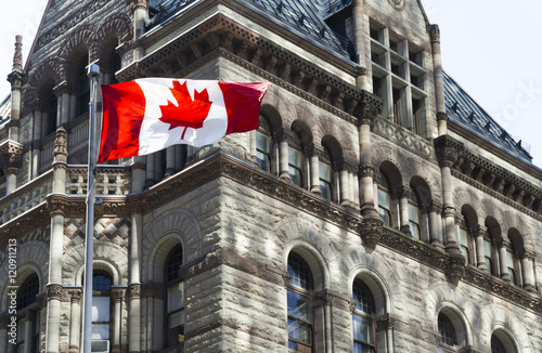 Canvas Toronto Beautiful Canada flag is waving front of a historical building
