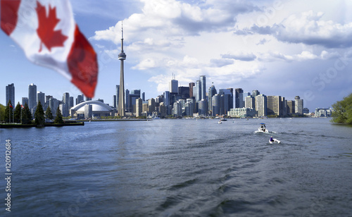 Fotobehang Toronto Beautiful Canada flag is waving front of famous Toronto City view