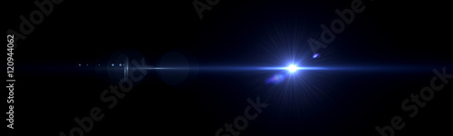 Beautiful light flares. Glowing streaks on dark background