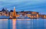 Stockholm city with illuminated christmas tree and Royal palace at christmas. - 120960437