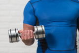 Close-Up Man Exercise Biceps With Dumbbells