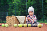 little boy and a tennis ball