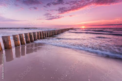 Plagát Wooden breakwater - Baltic seascape at sunset, Poland
