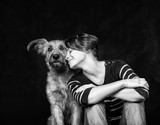 portrait of a beautiful young woman with a funny shaggy dog on a