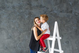 Mother and blond son on a step-ladder