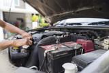Man repairing car.