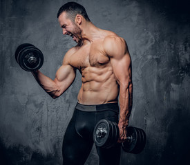Muscular male doing biceps workouts.