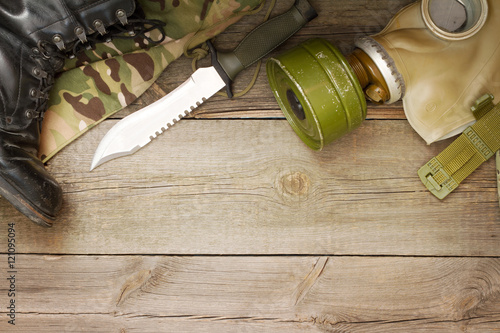 Poster Military accessories on wooden boards abstract background