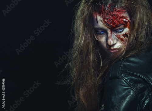 Close-up portrait of horrible zombie woman. Horror. Halloween Poster