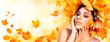 Fototapety Fall Girl - Beauty Model Woman With Orange Autumn Leaves Hairstyle
