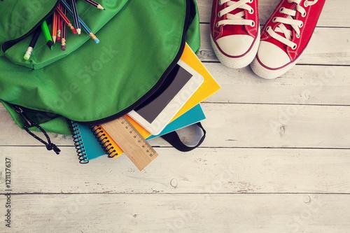 Fototapeta School backpack on wooden background