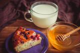 Fruit cake, honey and milk.