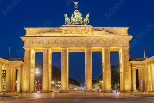 The famous Brandenburg Gate in Berlin illuminated at night Poster