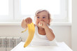 Baby eating fruit