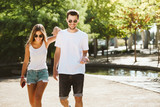 Beautiful young couple walking in the park.