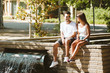 Beautiful young couple relaxing in the park.